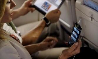 Чи можна користуватися телефоном в літаку?